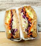 veggie & hummus sandwich with tahini lemon sauce